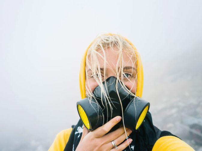 Woman In Respiratory Mask Posing In Smoke